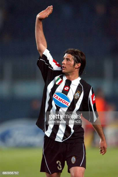 Juventus' Alessio Tacchinardi applauds the travelling support