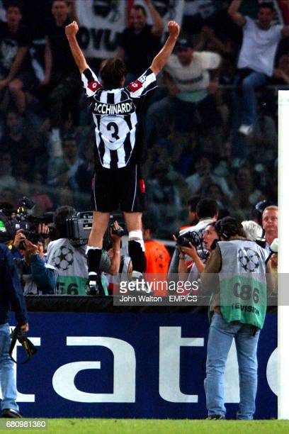 Juventus' Alessio Tacchinardi celebrates with the fans after his sides victory