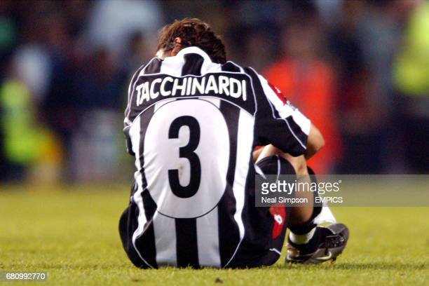 Juventus' Alessio Tacchinardi is dejected after defeat by AC Milan