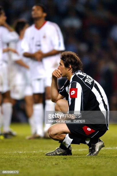 Juventus' Alessio Tacchinardi is dejected after losing to AC Milan