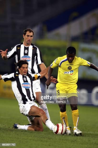 Juventus' Alessio Tacchinardi slides in to tackle Maccabi TelAviv's Ishmael Addo