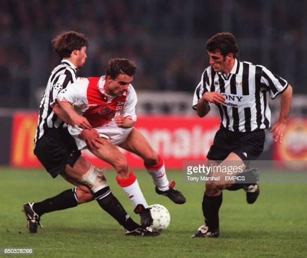 Juventus' Alessio Tacchinardi tackles Ajax's Marc Overmars watched by teammate Ciro Ferrara