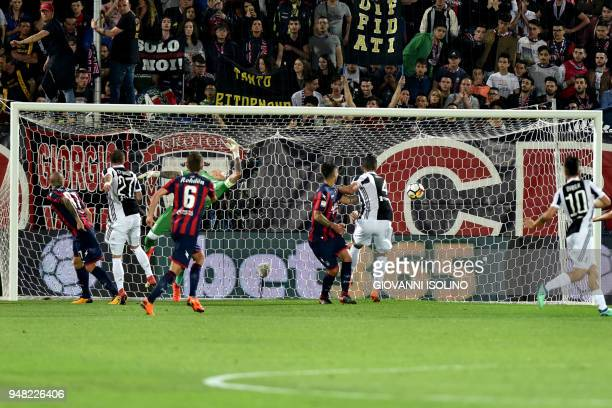 Juventus' Alex Sandro scores during the Italian Serie A football match FC Crotone vs Juventus on April 18 2018 at the Ezio Scida stadium in Crotone /...