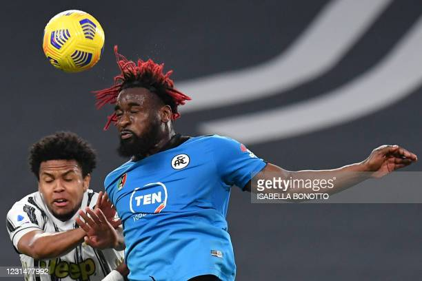 Juventus' American midfielder Weston McKennie and Spezia's French forward M'Bala Nzola go for a header during the Italian Serie A football match...
