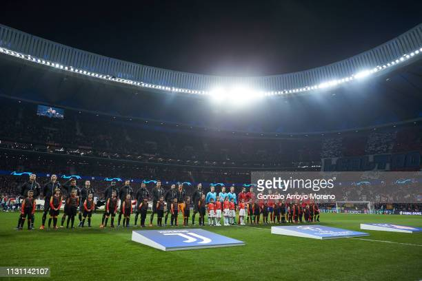 Juventus and Atletico de Madrid players stand prior to start the UEFA Champions League Round of 16 First Leg match between Club Atletico de Madrid...