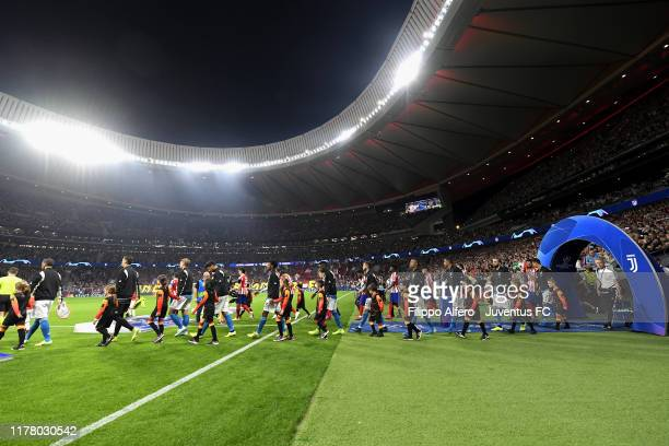 Juventus and Atletico players enter the pitch before the UEFA Champions League group D match between Atletico Madrid and Juventus at Wanda...