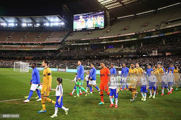 Juventus and Tottenham players walk out during the 2016 International Champions Cup match between Juventus FC and Tottenham Hotspur at Melbourne...
