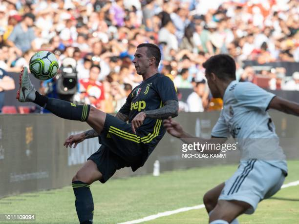 Juventus' Andrea Favilli controls the ball in front of Real Madrid's Sergio Reguilon during an International Champions Cup match at Fedex Field in...