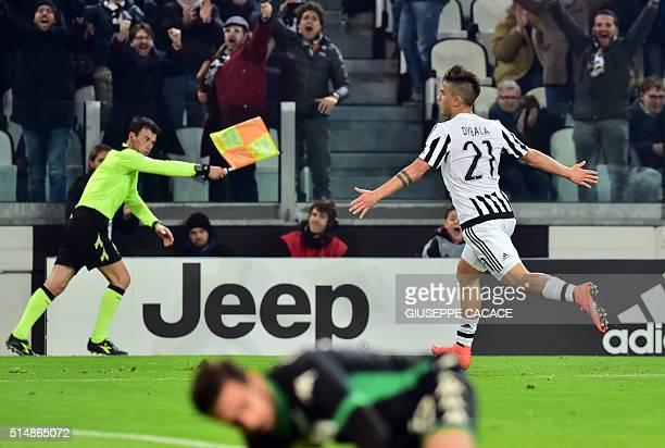 Juventus' Argentinan forward Paulo Dybala celebrates after scoring a goal during the Italian Serie A football match betwenn Juventus and Sassuolo on...