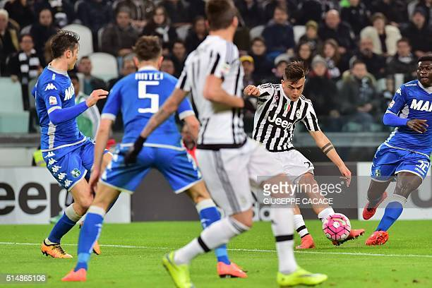 Juventus' Argentinan forward Paulo Dybala shoots to score a goal during the Italian Serie A football match betwenn Juventus and Sassuolo on March 11...