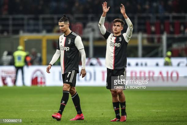 Juventus' Argentine forward Paulo Dybala acknowledges the public as Juventus' Portuguese forward Cristiano Ronaldo walks past at the end of the...