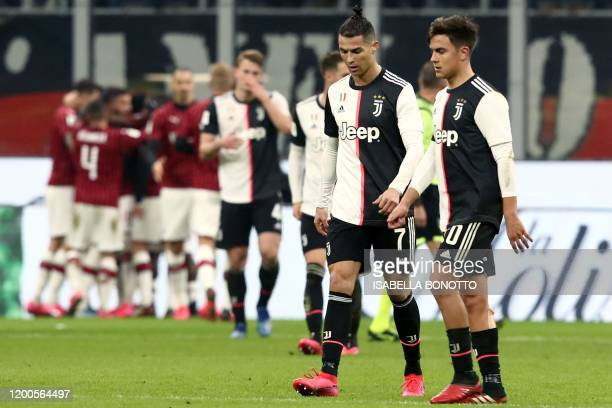 Juventus' Argentine forward Paulo Dybala and Juventus' Portuguese forward Cristiano Ronaldo react after AC Milan opened the scoring during the...