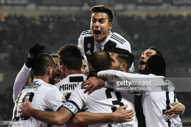 Juventus' Argentine forward Paulo Dybala and teammates celebrate after scoring during the Italian Serie A football match Torino vs Juventus on...