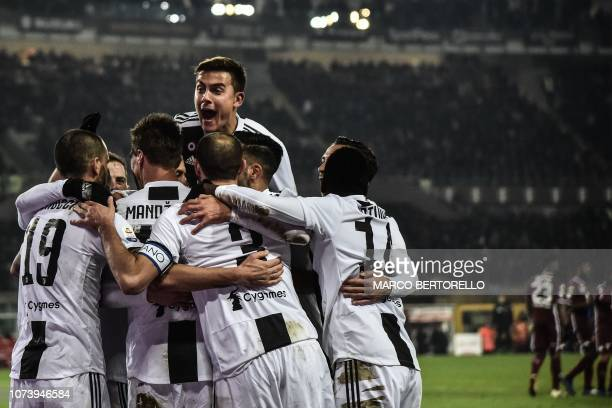 Juventus' Argentine forward Paulo Dybala and teammates celebrate after opening the scoring during the Italian Serie A football match Torino vs...
