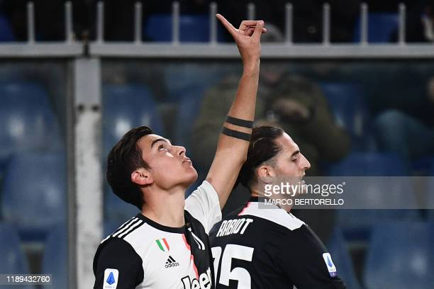 Juventus' Argentine forward Paulo Dybala celebrates after opening the scoring during the Italian Serie A football match Sampdoria vs Juventus on...