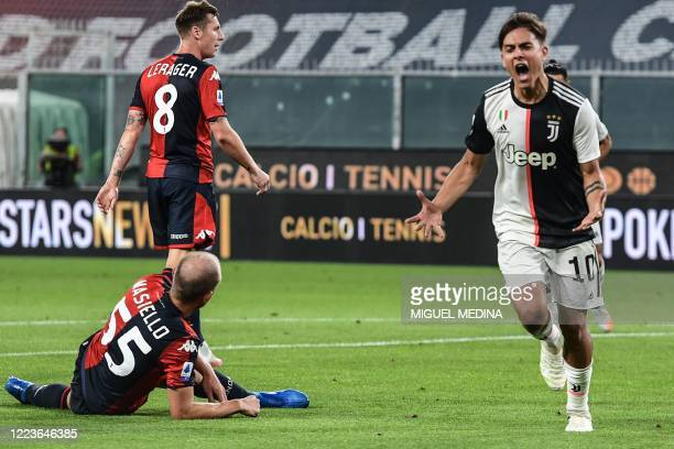 Juventus' Argentine forward Paulo Dybala celebrates after opening the scoring during the Italian Serie A football match Genoa vs Juventus played on...
