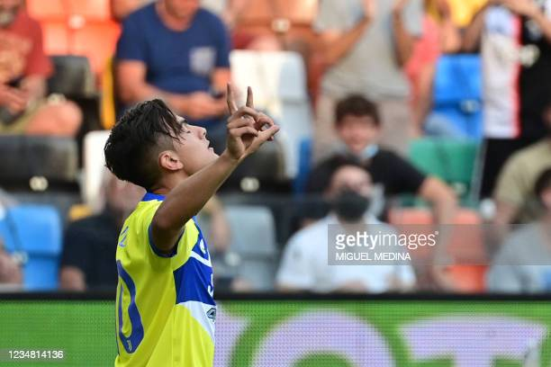 Juventus' Argentine forward Paulo Dybala celebrates after scoring a goal during the Italian Serie A football match between Udinese and Juventus at...