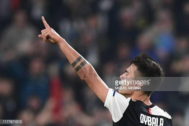 Juventus' Argentine forward Paulo Dybala celebrates after scoring an equalizer during the UEFA Champions League Group D football match Juventus vs...