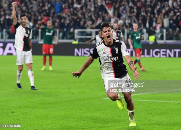 Juventus' Argentine forward Paulo Dybala celebrates after scoring his second goal during the UEFA Champions League Group D football match Juventus vs...