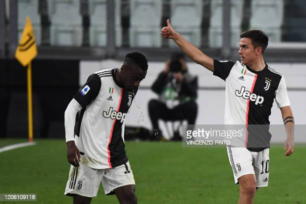 Juventus' Argentine forward Paulo Dybala celebrates after scoring their second goal during the Italian Serie A football match Juventus vs Inter...