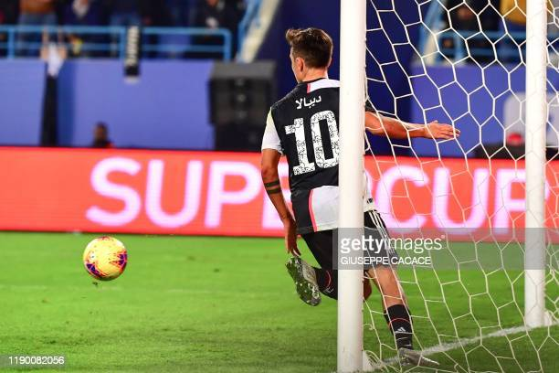 Juventus' Argentine forward Paulo Dybala celebrates after scoring during the Supercoppa Italiana final football match between Juventus and Lazio at...