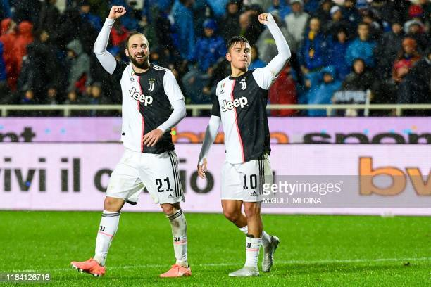 Juventus' Argentine forward Paulo Dybala celebrates with Juventus' Argentinian forward Gonzalo Higuain after scoring his team's third goal during the...