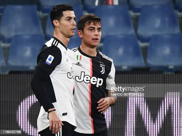 Juventus' Argentine forward Paulo Dybala celebrates with Juventus' Portuguese forward Cristiano Ronaldo after opening the scoring during the Italian...