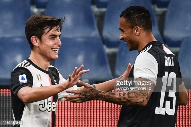 Juventus' Argentine forward Paulo Dybala celebrates with Juventus' Brazilian defender Danilo after opening the scoring during the Italian Serie A...