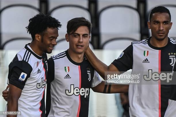 Juventus' Argentine forward Paulo Dybala celebrates with Juventus' Colombian midfielder Juan Cuadrado and Juventus' Brazilian defender Danilo after...