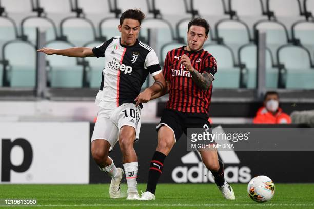 Juventus' Argentine forward Paulo Dybala challenges AC Milan's Italian defender Davide Calabria during the Italian Cup semifinal second leg football...
