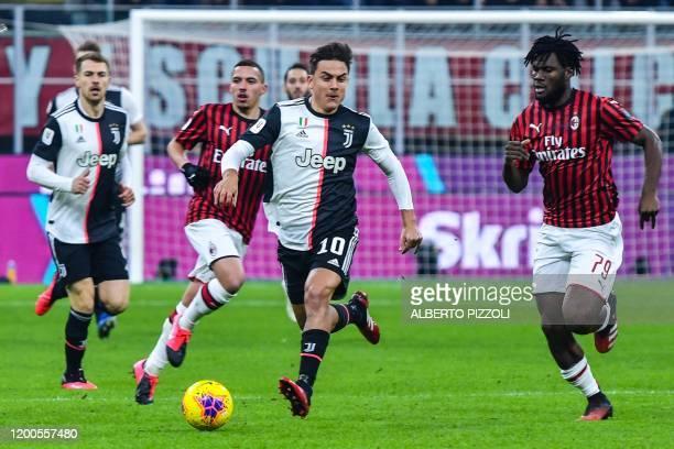 Juventus' Argentine forward Paulo Dybala challenges AC Milan's Ivorian midfielder Franck Kessie during the Italian Cup semifinal first leg football...