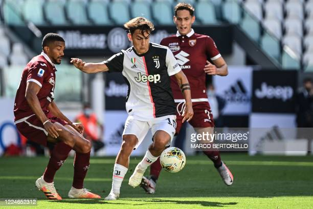Juventus' Argentine forward Paulo Dybala challenges Torino's Brazilian defender Bremer during the Italian Serie A football match Juventus vs Torino...