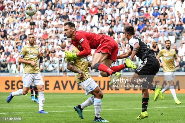 Juventus' Argentine forward Paulo Dybala collides with Spal's Albanian goalkeeper Etrit Berisha during the Italian Serie A football match Juventus vs...
