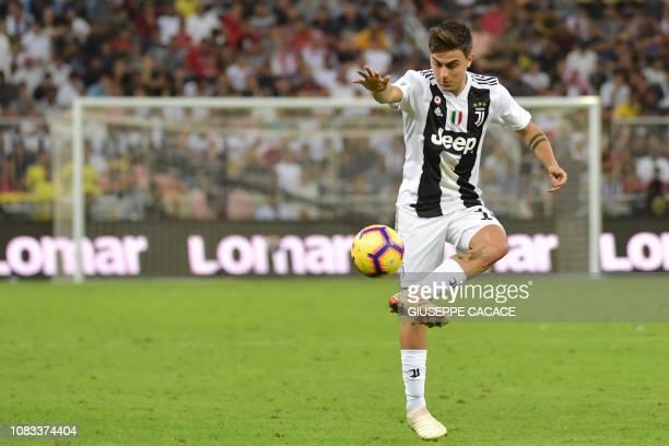 Juventus' Argentine forward Paulo Dybala controls the ball during their Supercoppa Italiana final between Juventus and AC Milan at the King Abdullah...