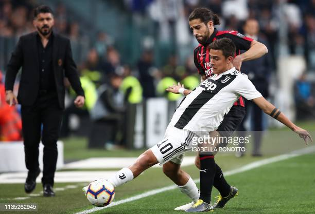 Juventus' Argentine forward Paulo Dybala holds off AC Milan's Swiss defender Ricardo Rodriguez during the Italian Serie A football match Juventus vs...