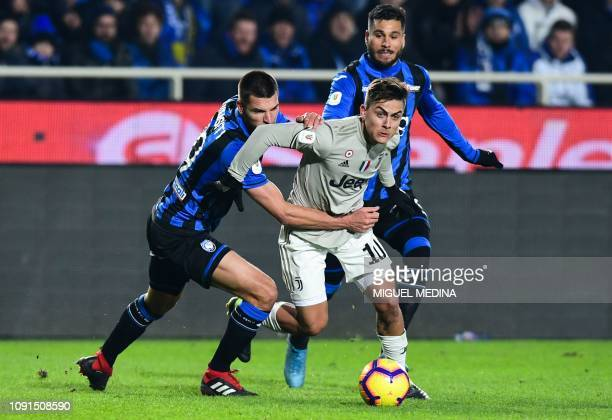 Juventus' Argentine forward Paulo Dybala outruns Atalanta's Albanian defender Berat Djimsiti during the Italian Tim Cup round of eight football match...