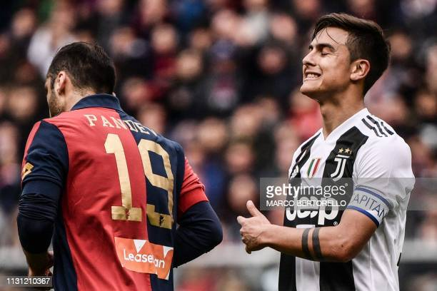 Juventus' Argentine forward Paulo Dybala reacts after Genoa's Macedonian forward Goran Pandev scored during the Italian Serie A football Match Genoa...