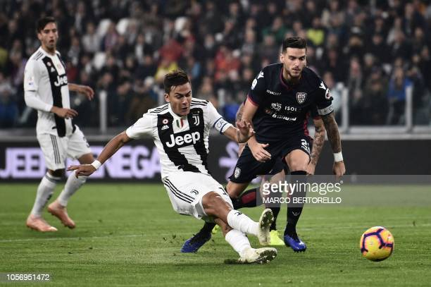 Juventus' Argentine forward Paulo Dybala scores during the Italian Serie A football match Juventus vs Cagliari at the Juventus Allianz stadium in...