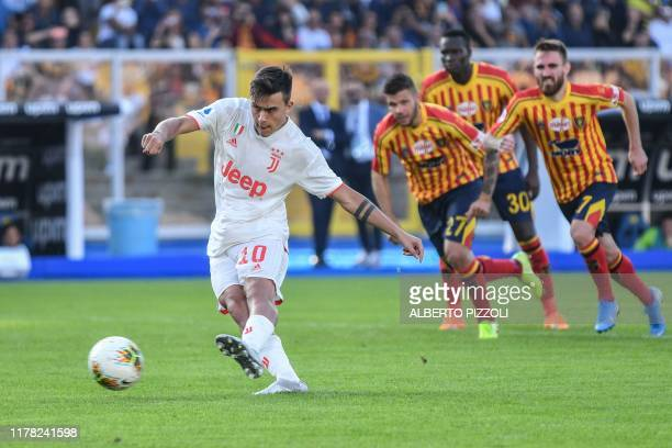 Juventus' Argentine forward Paulo Dybala shoots a penalty to open the scoring during the Italian Serie A footbal match Lecce vs Juventus on October...