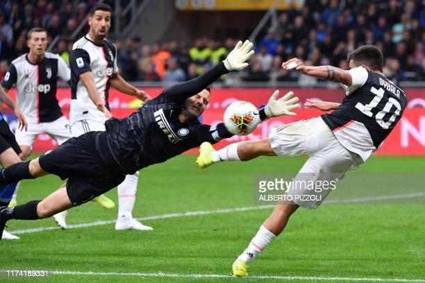 Juventus' Argentine forward Paulo Dybala shoots on goal against Inter Milan's Slovenian goalkeeper Samir Handanovic during the Italian Serie A...