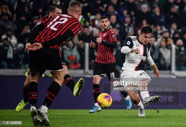 Juventus' Argentine forward Paulo Dybala shoots on goal during the Italian Serie A football match Juventus vs AC Milan on November 10 2019 at the...