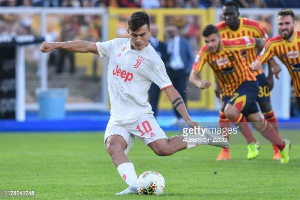 Juventus' Argentine forward Paulo Dybala shoots to score a penalty and open the scoring during the Italian Serie A footbal match Lecce vs Juventus on...