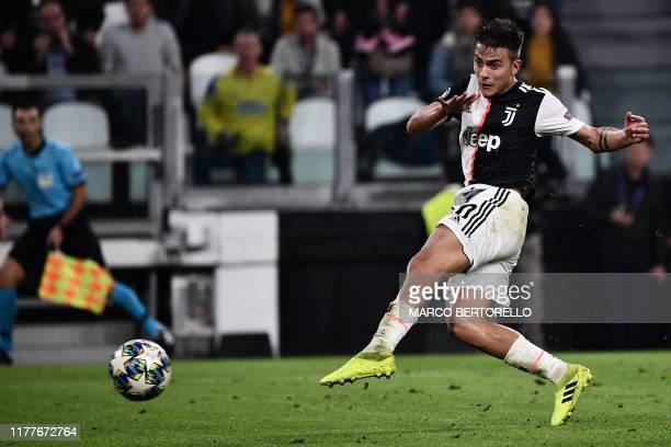 Juventus' Argentine forward Paulo Dybala shoots to score his second goal during the UEFA Champions League Group D football match Juventus vs...