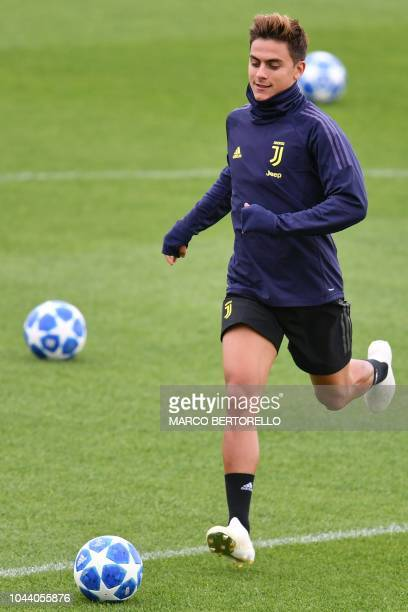 Juventus' Argentine forward Paulo Dybala takes part in a training session on the eve of the UEFA Champions League group H football match between...