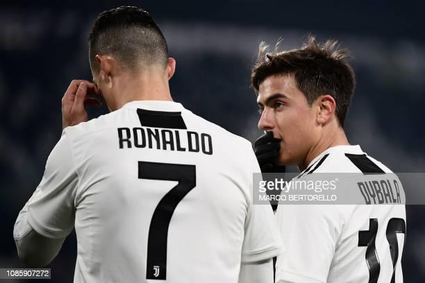 Juventus' Argentine forward Paulo Dybala talks to Juventus' Portuguese forward Cristiano Ronaldo during the Italian Serie A football match Juventus...