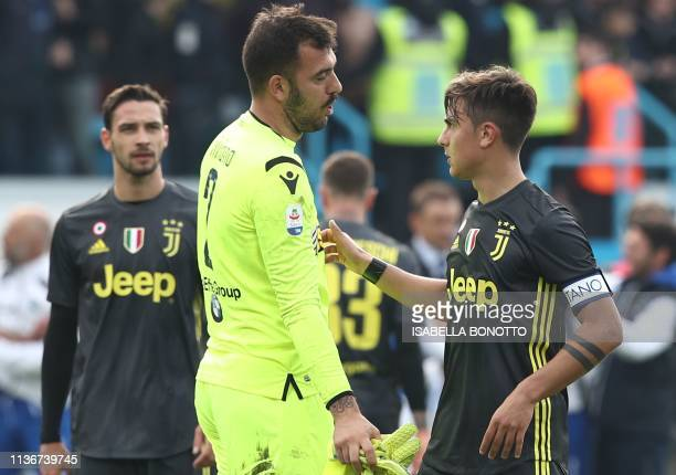 Juventus' Argentine forward Paulo Dybala talks with SPAL's Italian goalkeeper Emiliano Viviano at the end of the Italian Serie A football match SPAL...