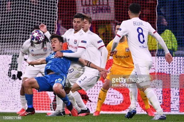 Juventus' Argentine forward Paulo Dybala vies for the ball with Lyon's Spanish midfielder Bruno Gomez Soares during the UEFA Champions League round...