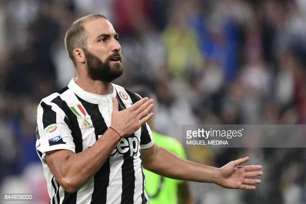 Juventus' Argentinian forward Gonzalo Gerardo Higuain celebrates after scoring during the Italian Serie A football match Juventus vs Chievo at the...