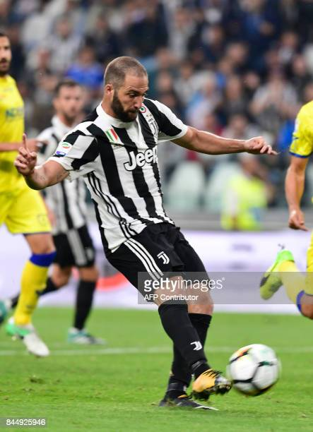 Juventus' Argentinian forward Gonzalo Gerardo Higuain shoots and scores during the Italian Serie A football match Juventus vs Chievo at the Allianz...