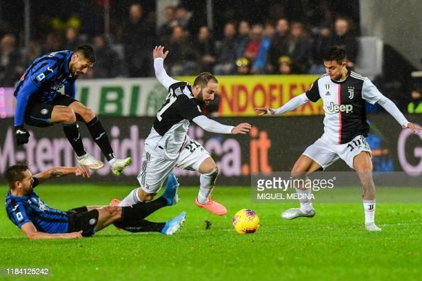 Juventus' Argentinian forward Gonzalo Higuain and Juventus' Argentine forward Paulo Dybala challenge Atalanta's Brazilian defender Rafael Toloi and...